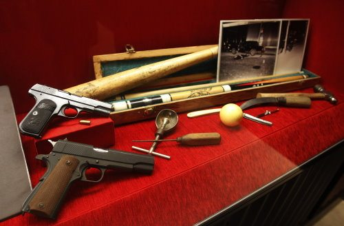 Weapons are on display at The Mob Museum on Monday, Feb. 13, 2012, in Las Vegas. It includes an oddball collection of household items — a shovel, a hammer, a baseball bat and an icepick— showing the creative side of some of America's most notorious killers. (AP Photo/Isaac Brekken)